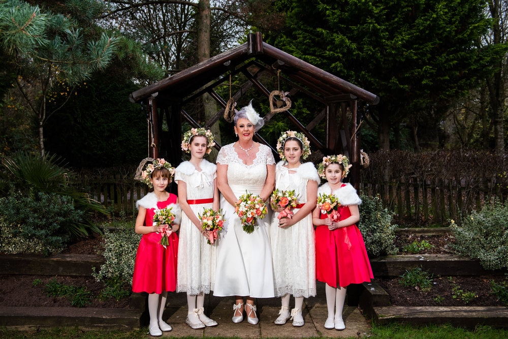 Group portrait of the Bride and her Bridesmaids