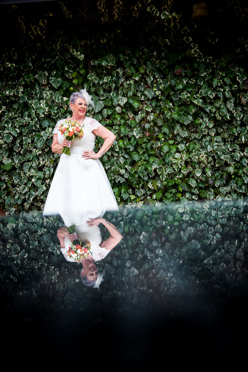 Outdoor portrait of the Bride reflected in a glass table