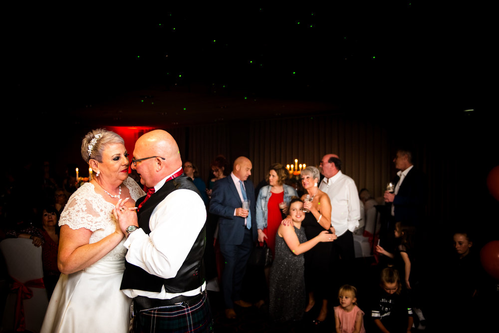 The married couple performing their first dance at the evening reception