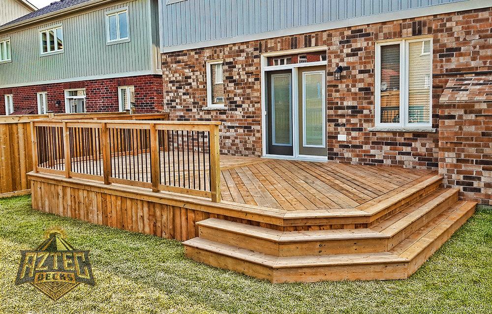 Bowmanville deck wraparound stairs deckorators railing pressure treated deck