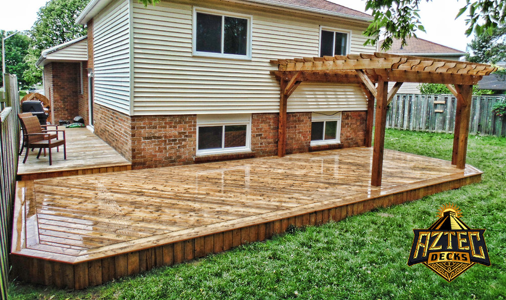 Courtice large deck with pergola and vertical skirting