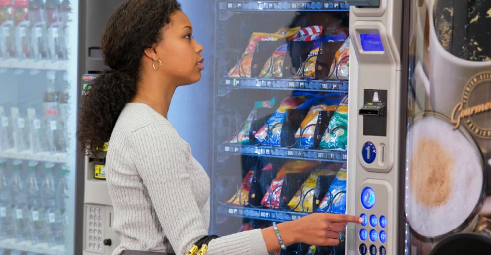 lady at vending machine.png
