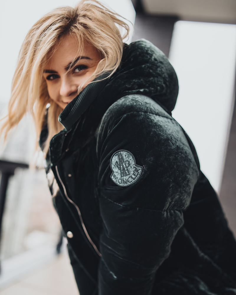 Monika of Monika Dixon Public Relations is wearing a green, velvet Moncler jacket. As a fashion blogger and influencer she enjoys finding pieces that are unique and stylish.
