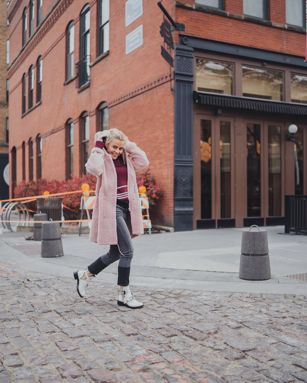 Monika Dixon of Monika Dixon Public Relations is wearing Frame jeans paired with a Calvin Klein sweater, Anne Vest jacket and Balenciaga boots.