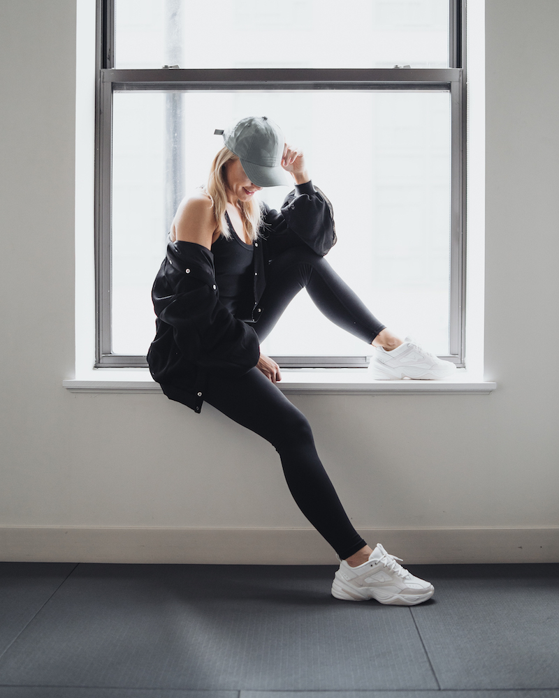 Monika Dixon of Monika Dixon Public Relations is wearing leggings, a tank top and jacket from Alo Yoga and Nike sneakers.