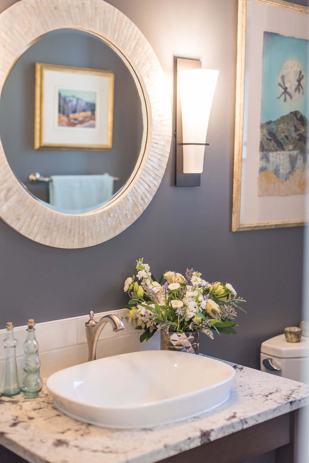 Powder Room with sconce lighting| Alaska White Granite| Benjamin Moore Trout Gray paint| Interior Designs By Adrienne| Cranbrook BC
