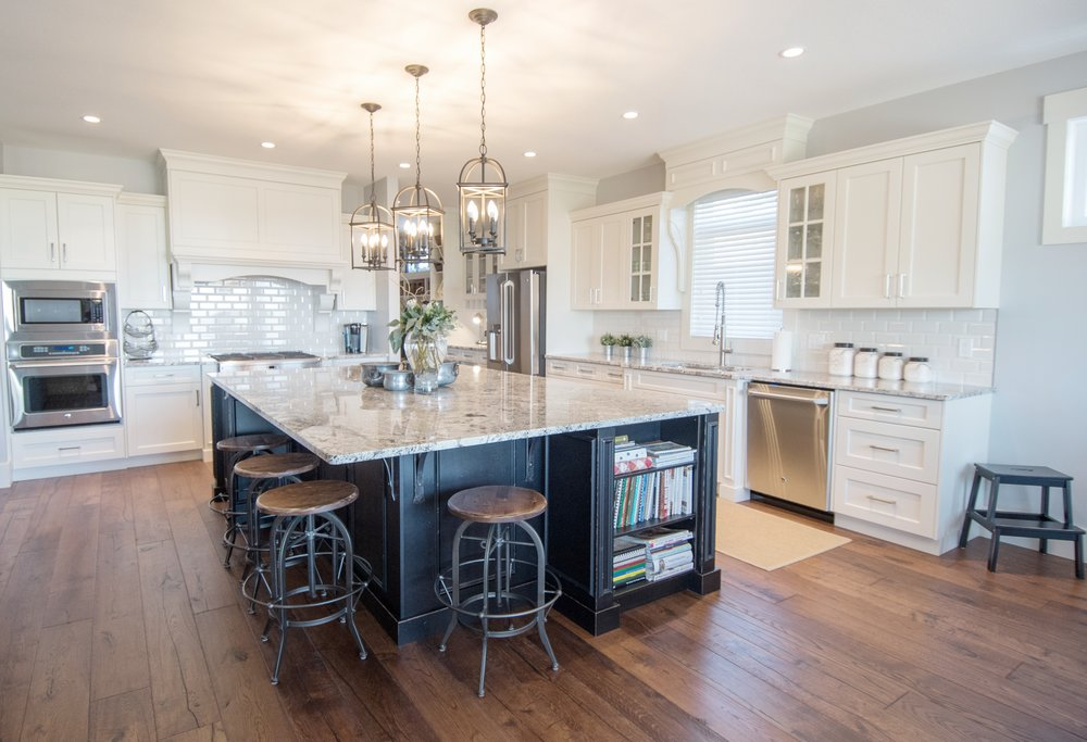 Traditional white cabinets with black painted island and pendant lighting, metal and wood bar stools, Benjamin Moore Stonington Gray, Interior Designs By Adrienne, Cranbrook BC