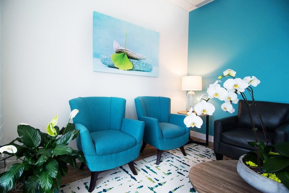 Spa reception area, blue mid century modern chairs, Flor carpet tiles, Interior Designs By Adrienne, Cranbrook BC