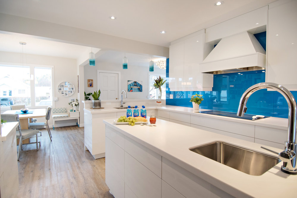 HIGH GLOSS WHITE CABINETS, VENARO WHITE CORIAN, WHITE KITCHEN, GLASS BACKSPLASH, STAINLESS STEEL APPLIANCE, CLASSIC GREY BENJAMIN MOORE, INTERIOR DESIGNS BY ADRIENNE, CRANBROOK BC