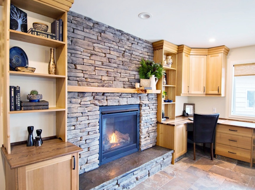 Stone fireplace with natural gas insert and builtin bookcase