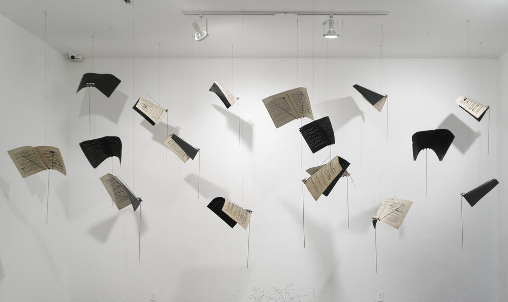 Maria Edwards,  Uni-versos, 2013 , perforated and painted music sheets, guitar pegs, bicycle spokes, steel rods and black threads. Dimension variable. Photo Courtesy of Arroniz Arte Contemporaneo.