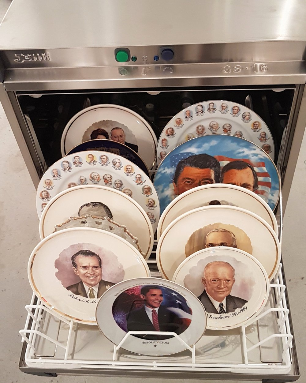 Eugenio Merino,  Face Wash , 2016. Industrial dishwasher with commemorative plates, 32 × 23 × 38 in. Unix Gallery at Art Miami Fair.