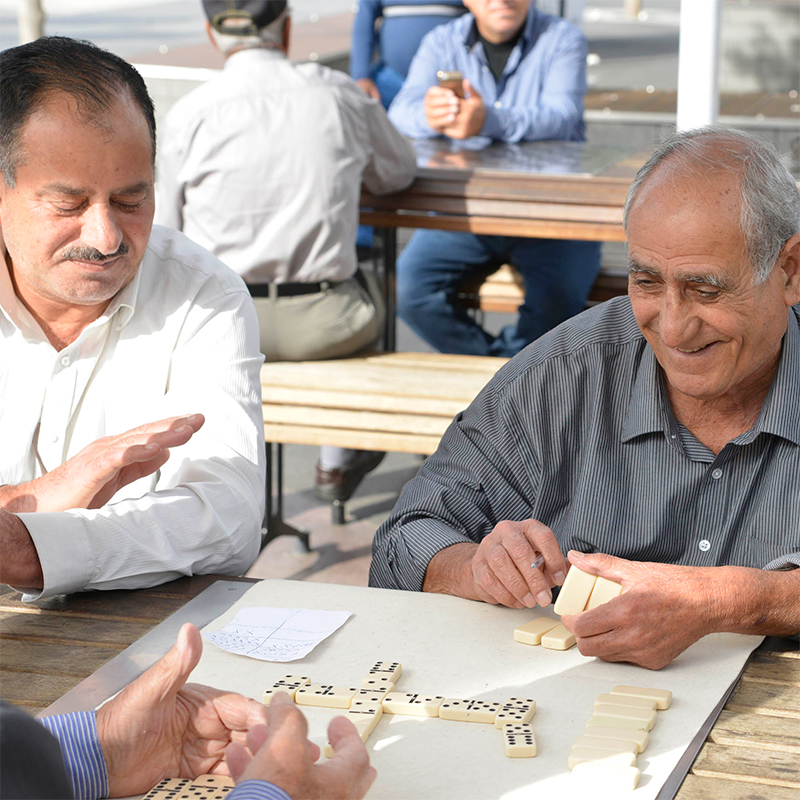 Three men playing dominoes