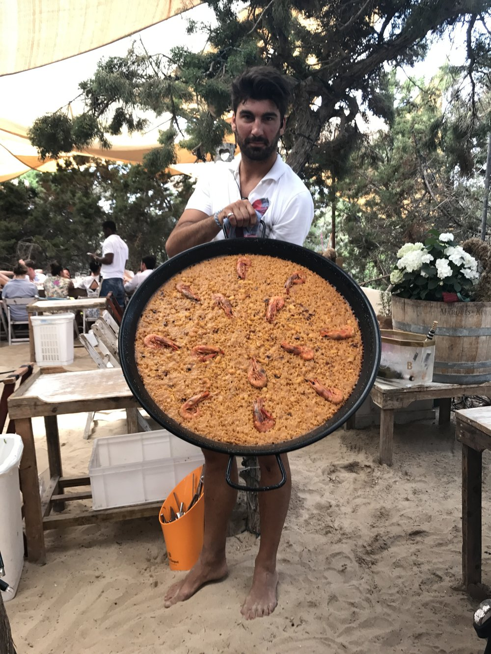 Delicious paella lunch on the beach in Spain
