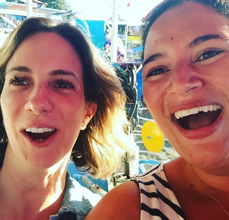 Leslie and best friend Lei riding taking a terrifying ride on a roller-coaster at the county fair