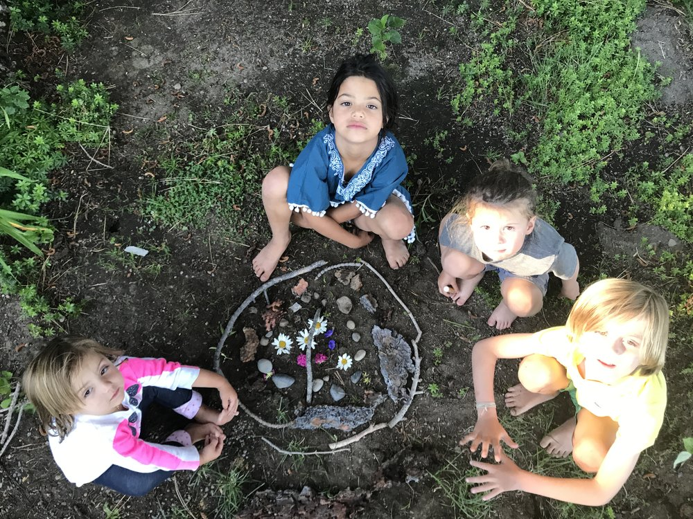 Kids making art with flowers and rocks in Lake Tahoe
