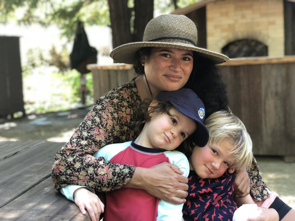 Leslie's best friend Leilengoa with Silas and her son Felix after walking in the organic garden and picking out eggs from the chicken coop and picking fruit at Leslie's dad Lynn's house in Sonoma