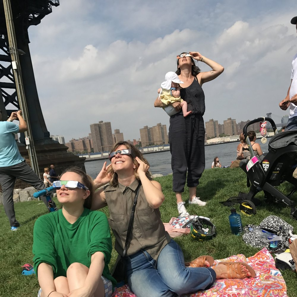 Watching the solar eclipse in the park close to our house with friends
