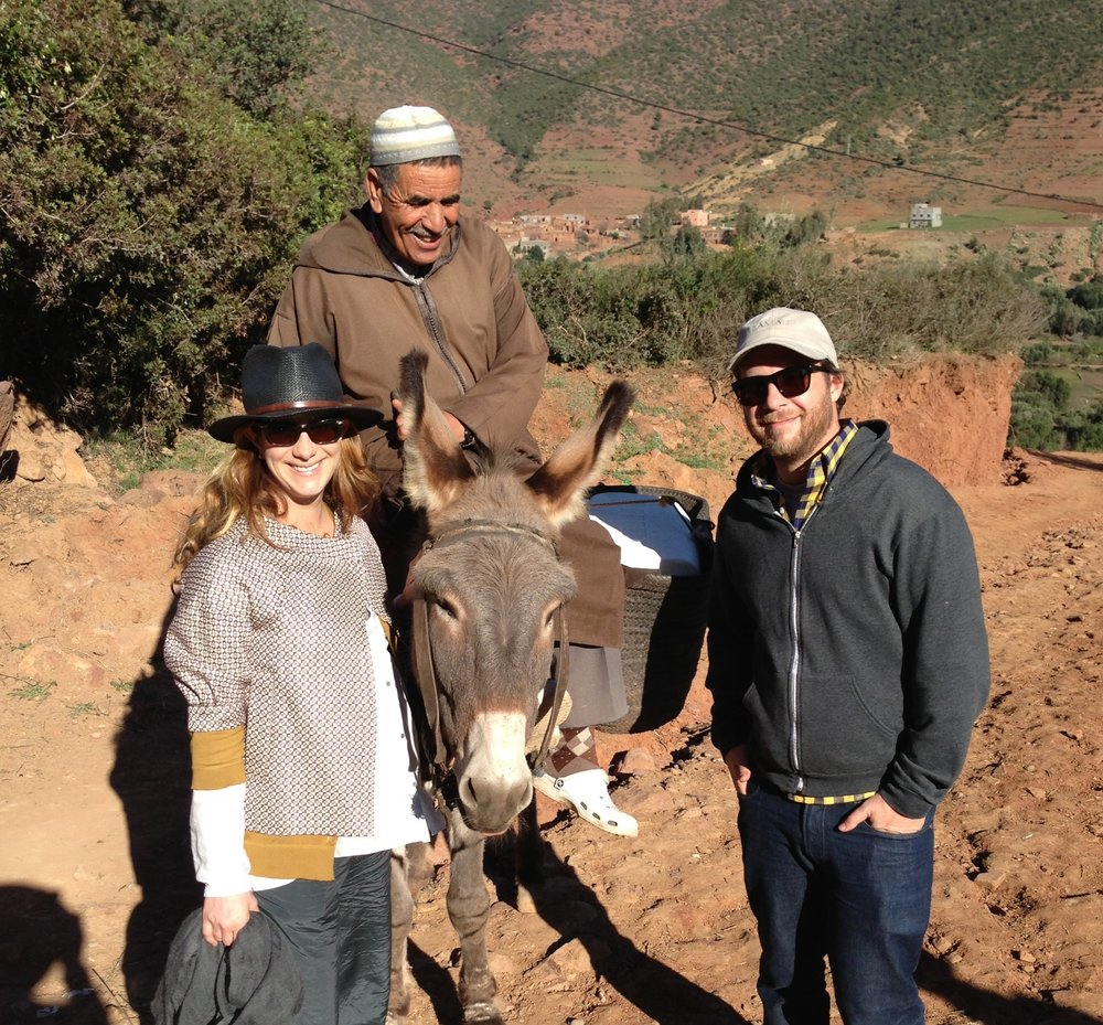 Leslie and Jason hiking to a rural mountain village in Morocco
