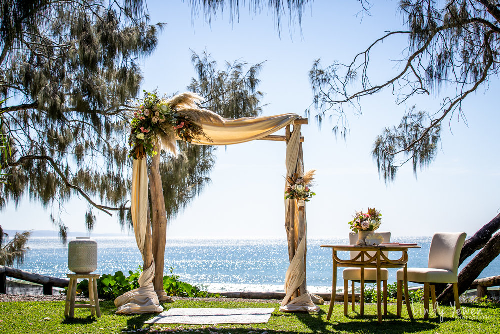 Ceremony Locations - The Noosa area has some of the most iconic and world renowned photographic locations for your wedding day, equal to anywhere in the world. Our most recognised sites are situated along the beautiful Noosa Boardwalk, with grass or sand underfoot, Casuarina trees offering shade above, and the Noosa Heads main beach and across to the Coloured sands behind.