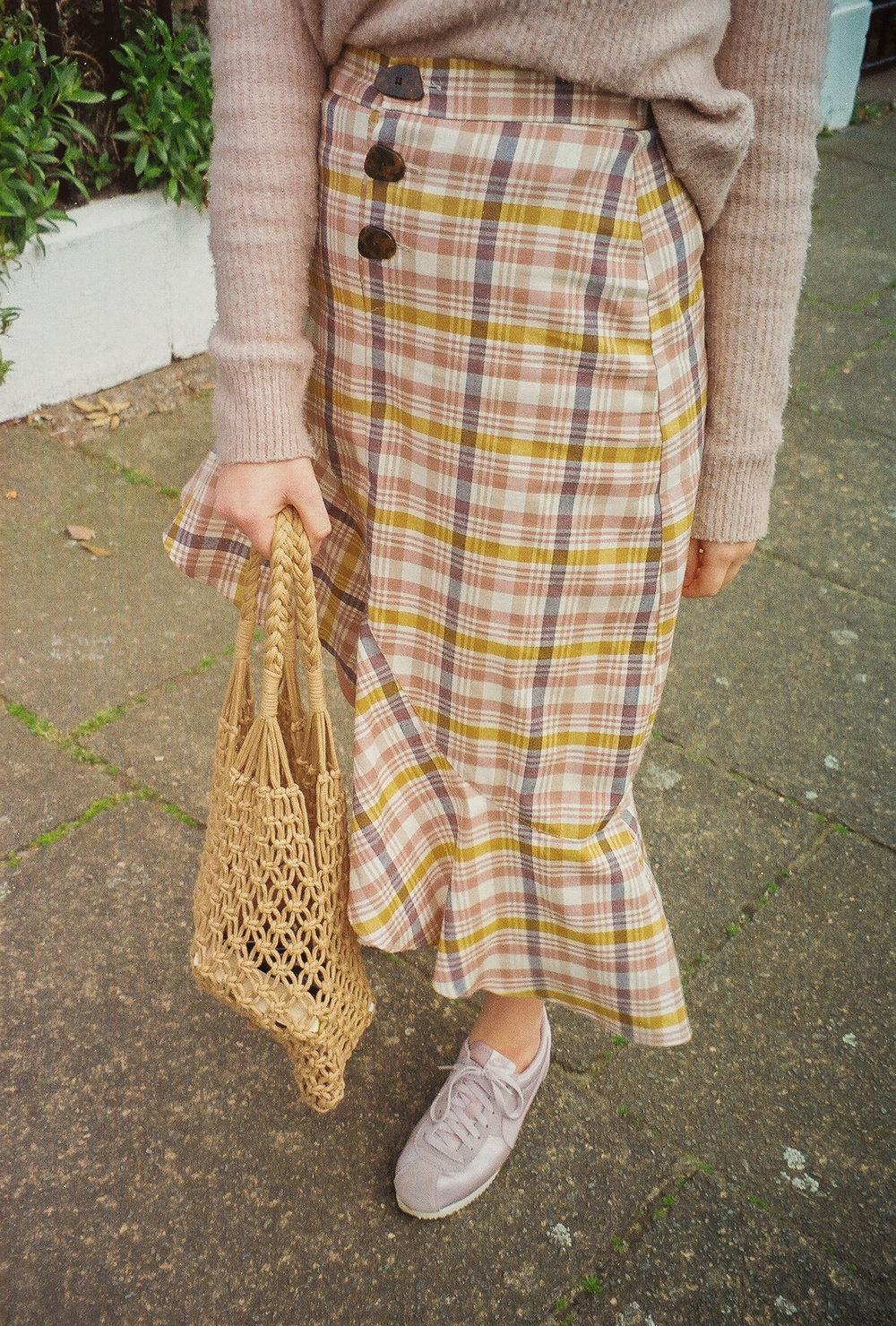 pastel check skirt straw bag
