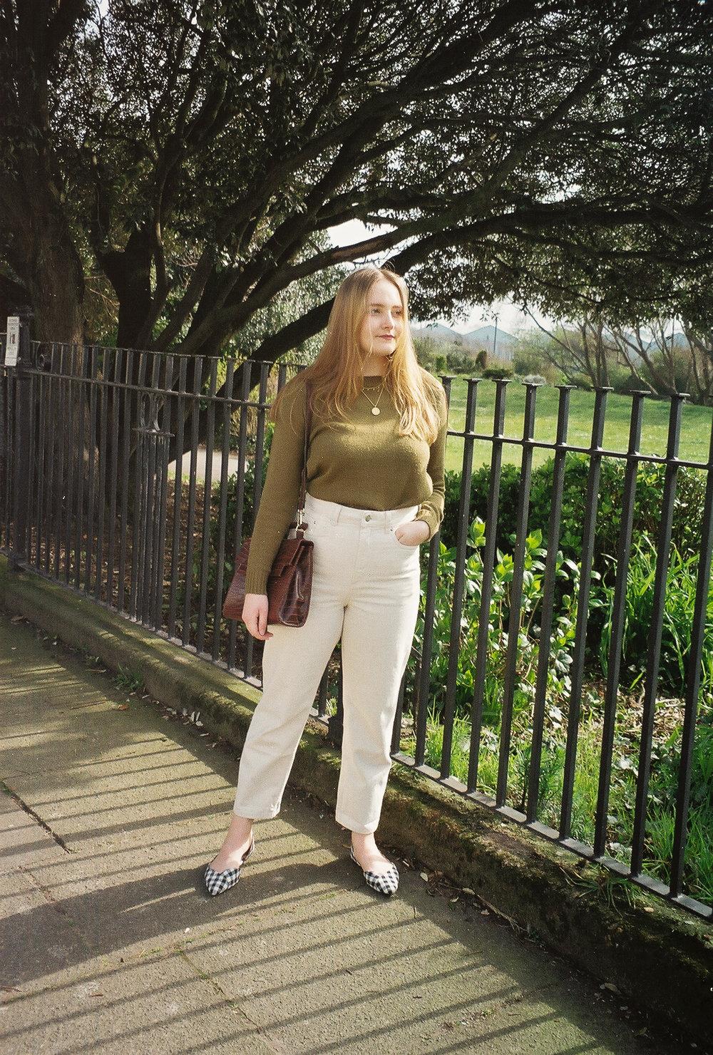 cream jeans green jumper