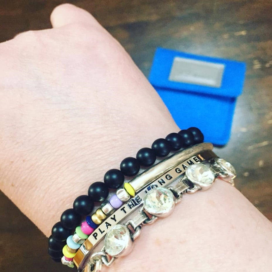 It's an arm party with my new 99 Walks bracele t . Can't wait to add more as I reach my goals!  -Kelly walked with a team to get their 99 miles!