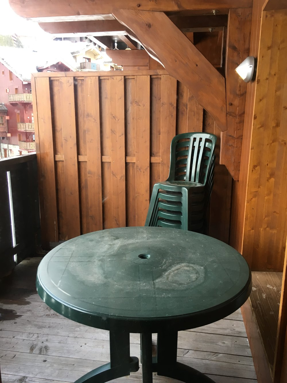 balcony table chairs view varanda outside area.jpeg