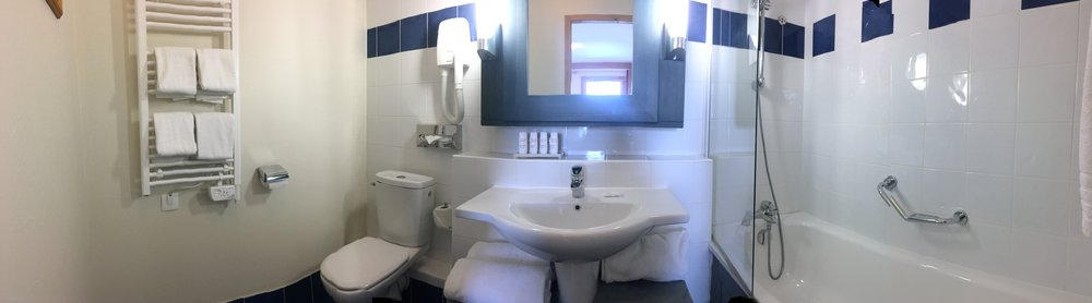 Bathroom pano arc 1950 bath shower sink loo toilet .jpg