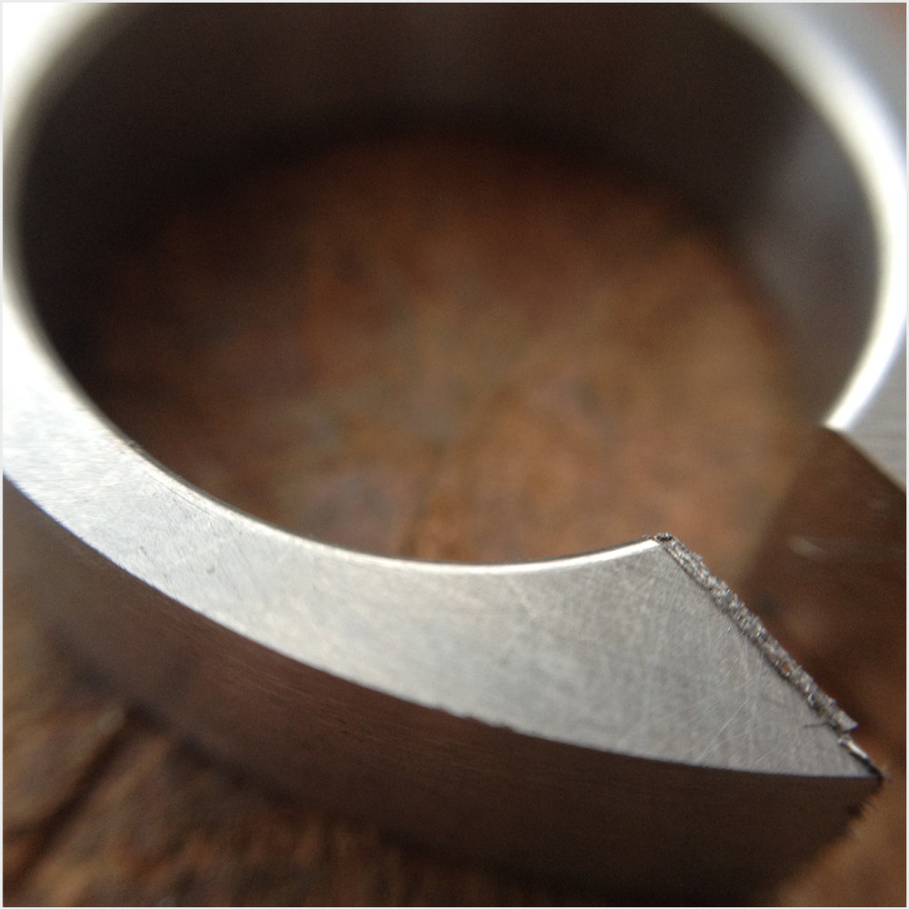 stainless steel band tapered to accept height of raw diamond