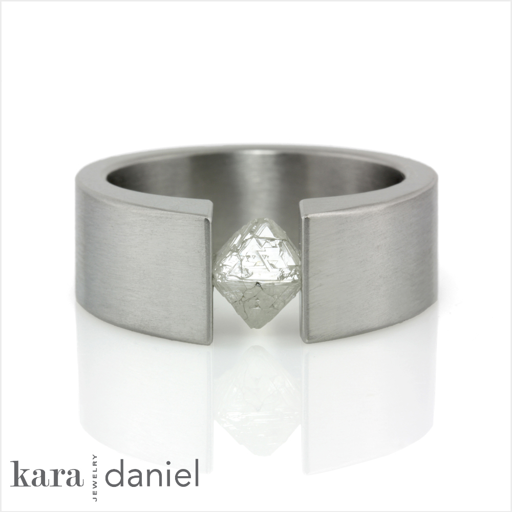 the finished raw diamond, tension-set ring