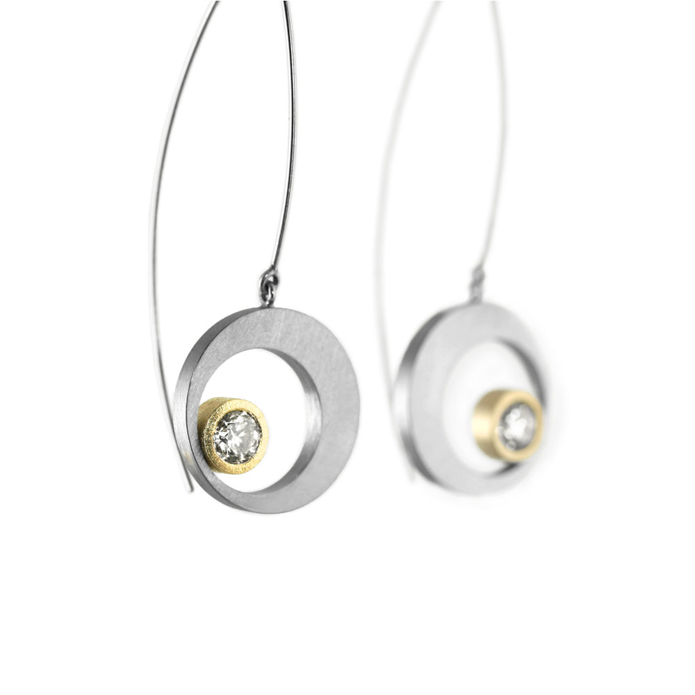 eclipse earring with 22kt gold bezels.