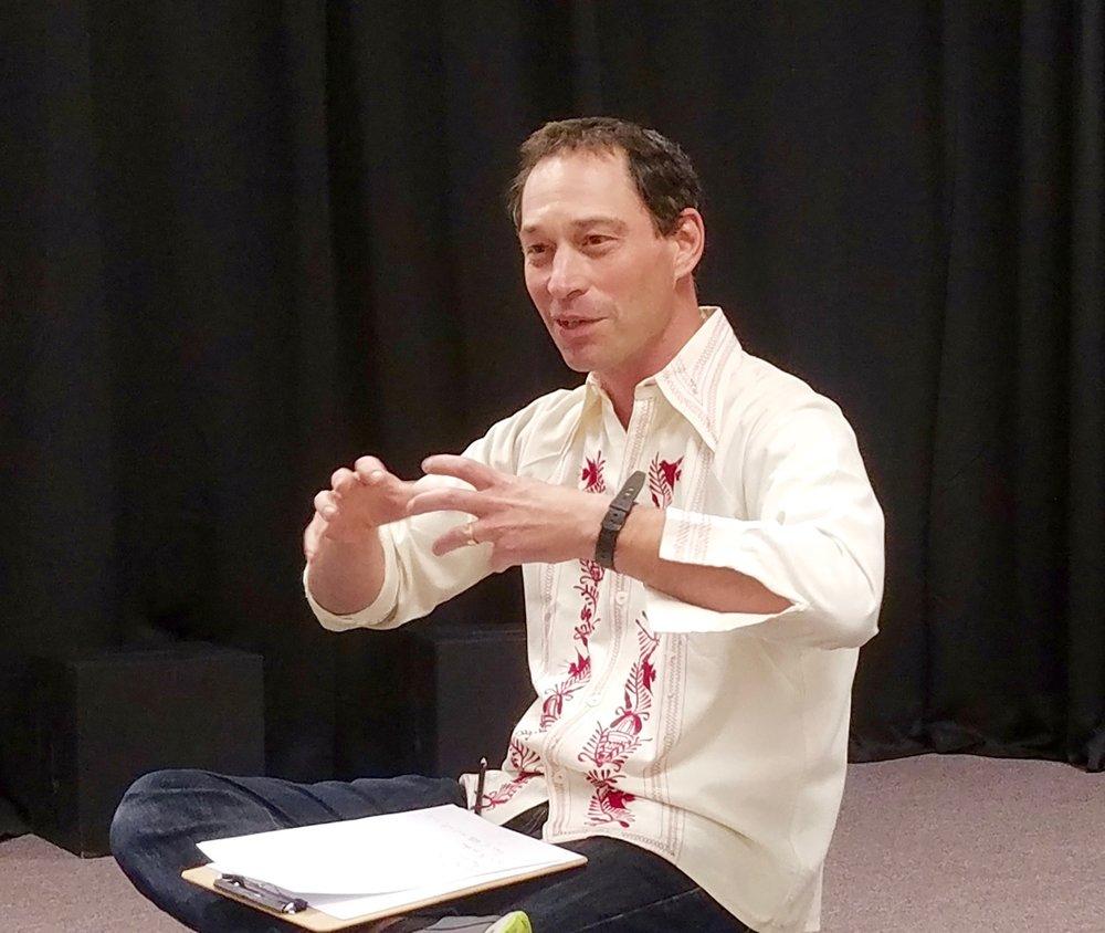 Charles teaching.jpg