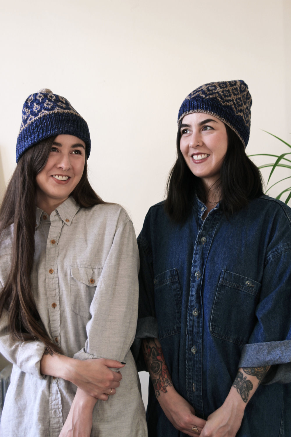 Half Japanese twin women wearing hand knit toques.