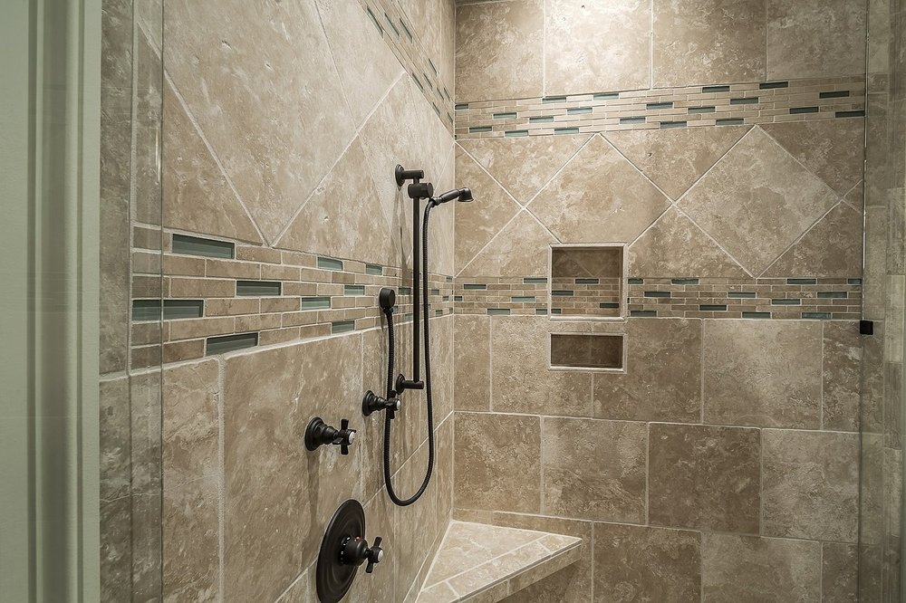 You can customize your walk in shower with a corner bench or shower niche to hold shampoos and soap. Think about your needs in advance and then talk over your options with your contractor.