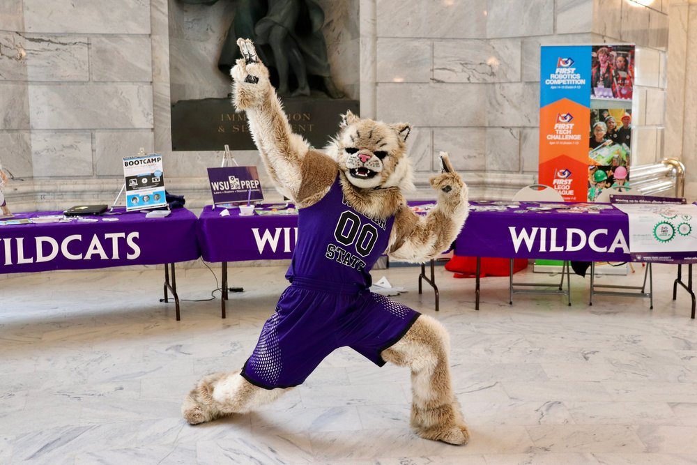 Waldo Wildcat shows his moves in the Capitol rotunda.