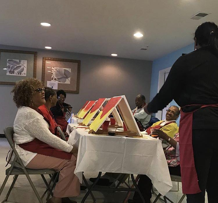 """Senior Paint + Sip at Windsor Crossing Apartments, """"African Sunset"""" instructed by Anika Fountain, founder of Arts On the Pike, 11/10/18"""
