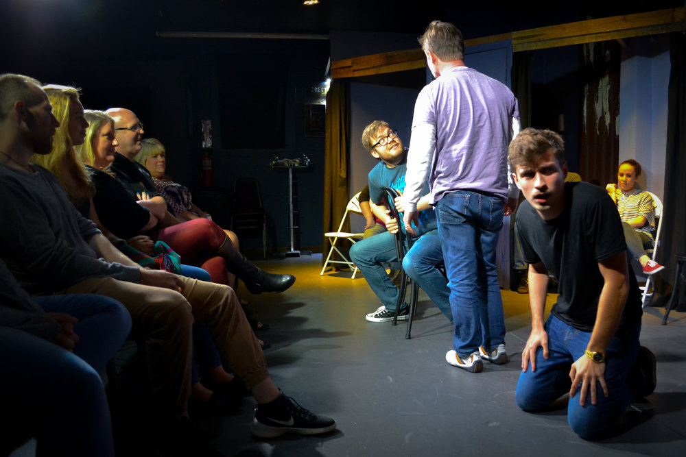 Spencer Cross playing Sit, Stand, Kneel in Whose Line St Pete with Warren Buchholz and Mike McNeil.