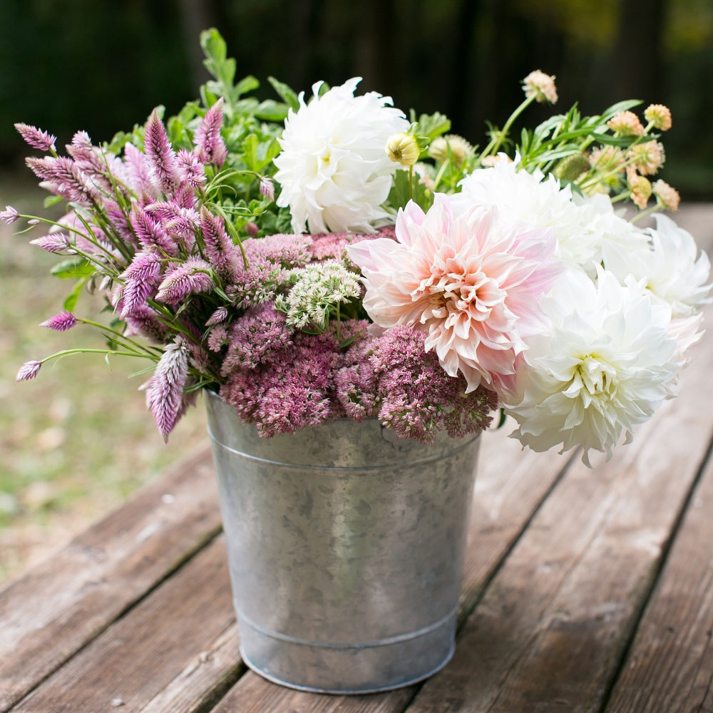 DIY - This option caters to those of you who are energized by creating your own wedding arrangements and designs. We offer bulk blooms in three color palettes, filled with unique seasonal flowers direct from our farm. Bulk blooms are available from mid June - September. A minimum order of $200 for bulk blooms is required, average bulk blooms expenses for weddings of 150-200 guests are $400-$600. Learn more of the details from our DIY Wedding page.