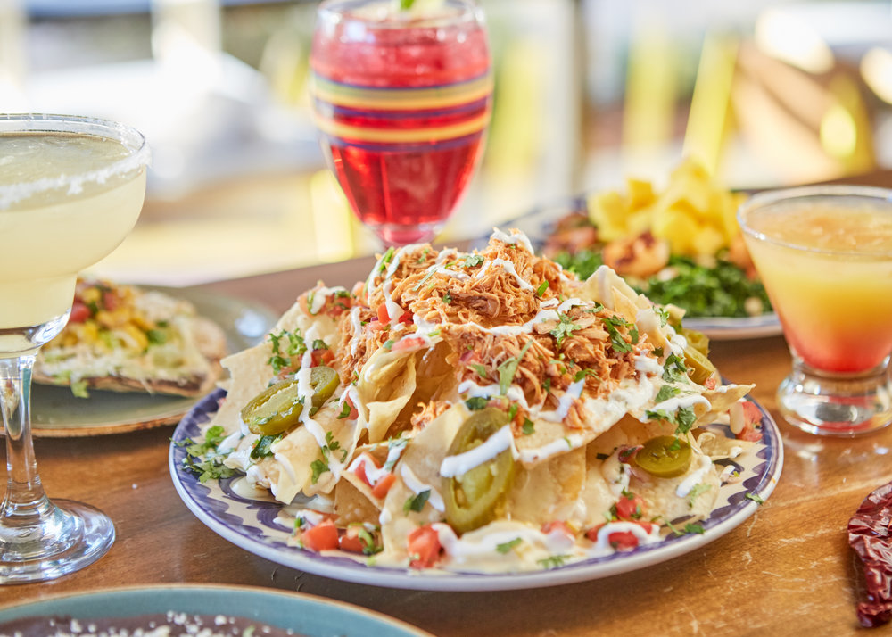 NACHOS $8.99 - House-made chips, cheese, pico de gallo, jalapeños and sour cream with your choice of: BRISKET, CHIPOTLE CHICKEN, CARNITAS, BEEF OR CHICKEN FAJITA, or GRILLED VEGGIES