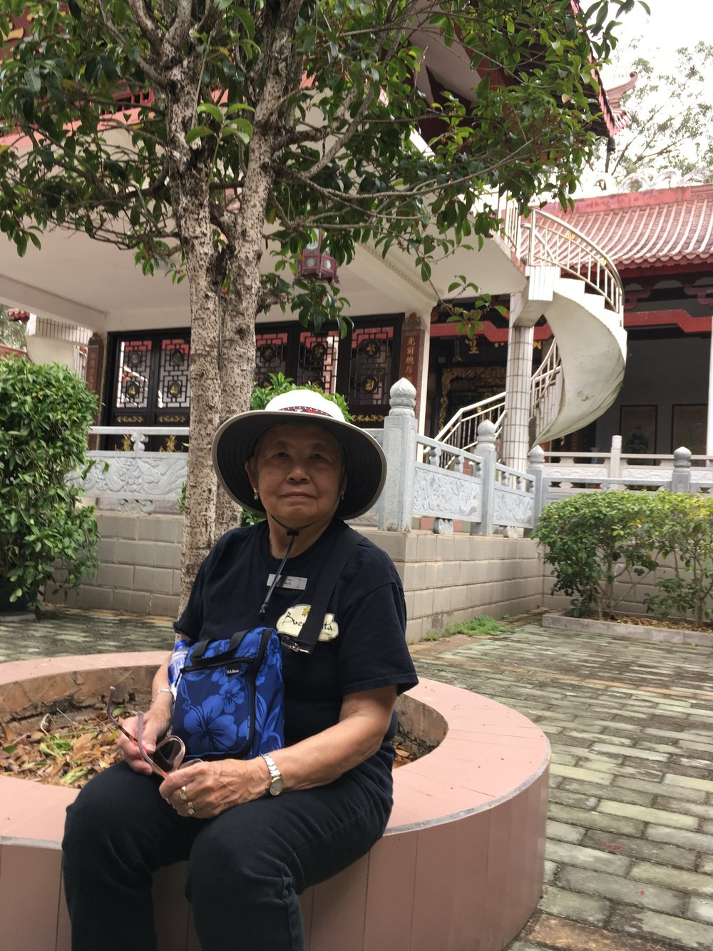 My mom in the inner courtyard of the ancestral hall