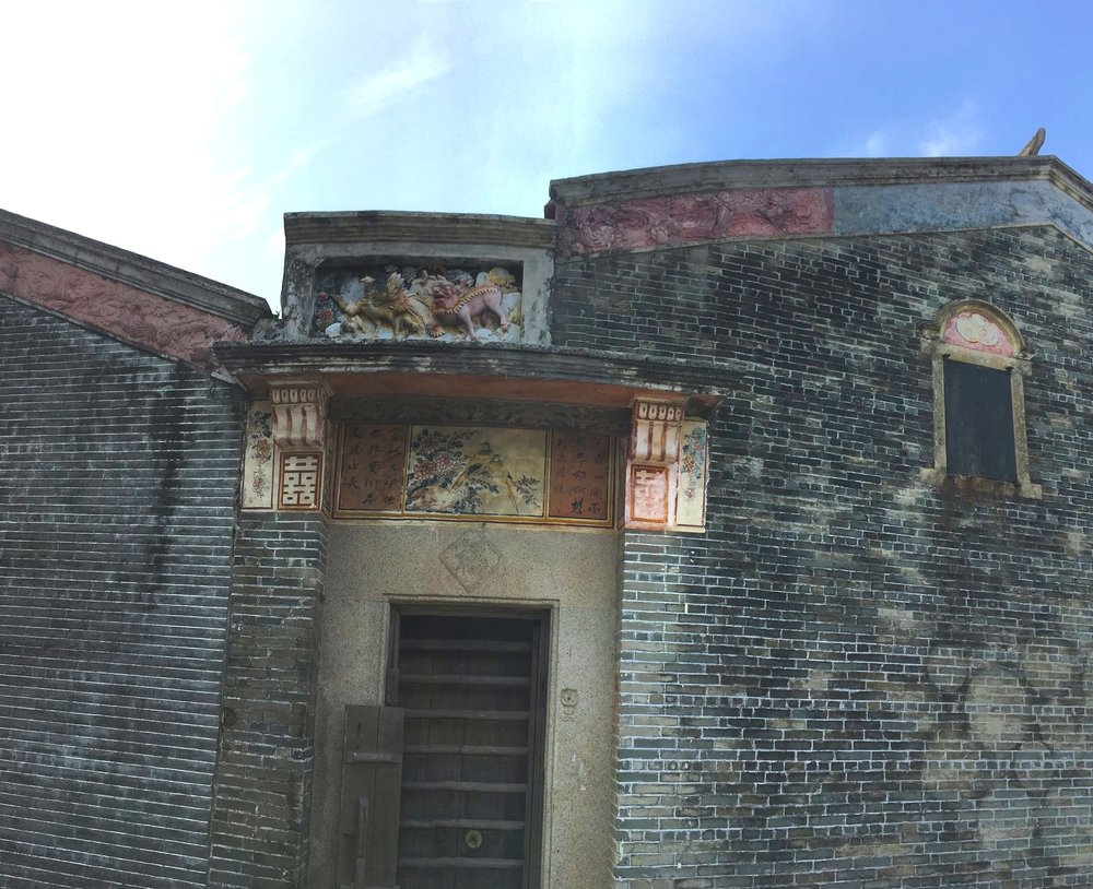 Carved stucco and fresco painted ornaments above an entranceway