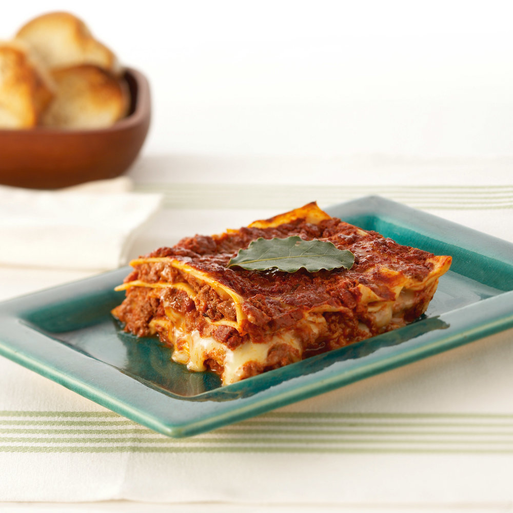 Lasagnas - Our lasagnes are made to a traditional recipe, lots of silky pasta layers that we make ourselves with bolognese or tomato sauce that we cook for hours, just like our Nonna did. We use only the freshest ingredients so you can pass off this delicious dish as your own! Available in Traditional Meat (1kg, 500gm, 300gm), Pumpkin, spinach & ricotta (500gm, 300gm), Roasted Vegetables with fresh basil (500gm), Vegan (500gm), Organic Beef (500gm), Organic Beef & hidden vegetables (300gm) and Moroccan lamb (500gm). Other seasonal varieties are available exclusively at farmers markets.