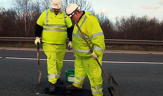 pothole problem - workers