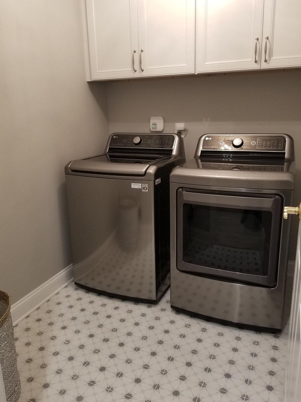 Mosaic laundry floor and storage