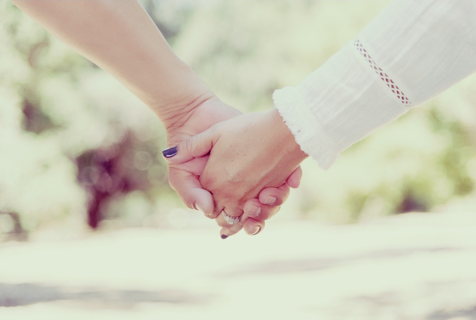 Canva holding hands.jpg