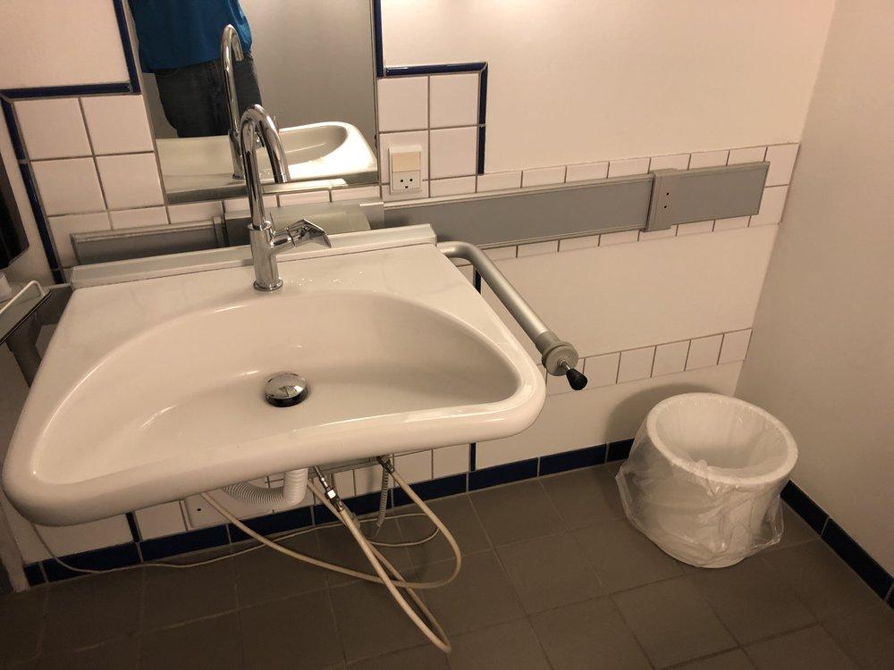 Adjustable sink in bathroom.