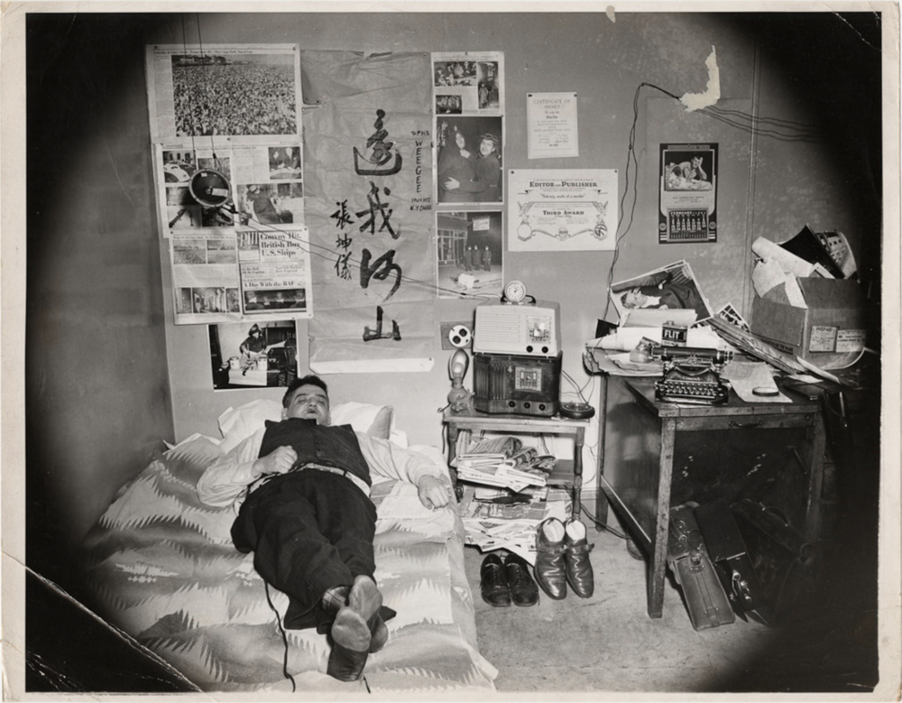 A self-portrait of Weegee in his bedroom, c. 1937. This and another similar photo served as inspiration for the bedroom recreation featured in the exhibit.