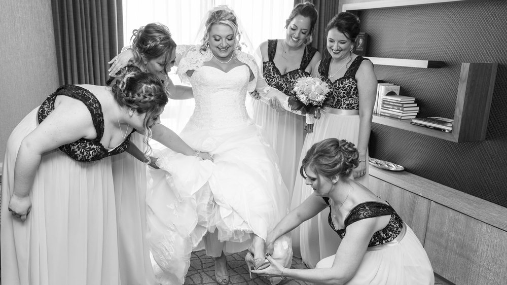 Bride-Getting-Ready-with-Bridesmaids-2.jpg