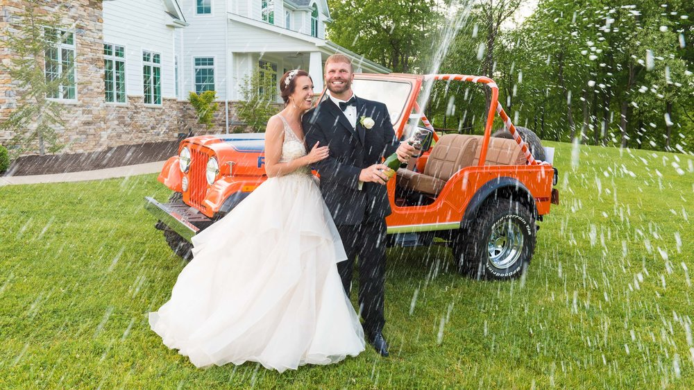 Bride-and-groom-champagne-blast-orange-jeep.jpg